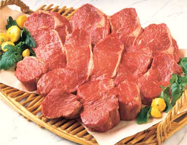 Bamboo platter with 15 cuts of uncooked beef, including ribeye, New York and filet mignon
