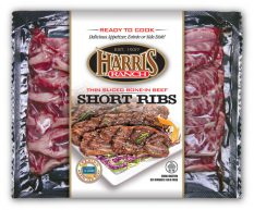 Vacuum packed package of REady to Cook, Delicious Appetizer, Entree or Side Dish! Harris Ranch Thin Sliced Bone-in Beef Short Ribs with Harris Ranch logo, Est 1937 and image of cooked ribs on platter with green and red cabbage garnish