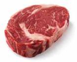 uncooked cut of beef - ribeye steak