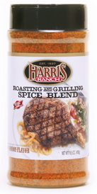 Unopened container of Harris Ranch Roasting and Grilling Spice Blend. Clear bottle with black lid. Spices are red-orange